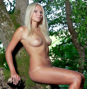Femjoy blonde in a tree